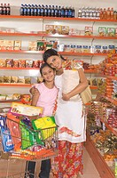 Mother hugging daughter shopping in supermarket MR748A,748D