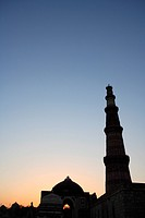 Sunset at Qutab Minar built in 1311 red sandstone tower , Indo_Muslim art , Delhi sultanate , Delhi, India UNESCO World Heritage Site