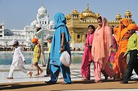Pilgrims walking around Golden Temple by the holly lake, Punjab Amritsar India