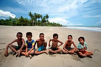 Children on the beach of the south coast with Beaco in sueder from the east Timor with Tutuala, the east Timor.