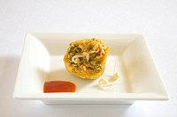 Indian cuisine , fast food starters half Moong Vada fritters Phaseolus aureus served with tomato ketchup in dish on white background