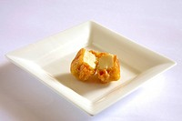 Indian cuisine , fast food starters Cheese Pakode puffs served in dish on white background