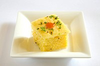 Indian cuisine , fast food Dhokla served with tomato ketchup in dish on white background