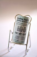 Concept , Indian currency one hundred rupees on relax stainless steel chair