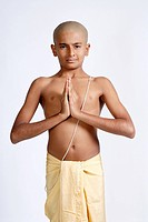South Asian Indian bald boy in dhoti wearing sacred thread doing Namaskar MR719