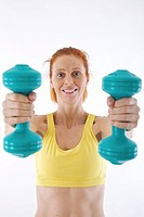 Woman exercising with dumb_bells