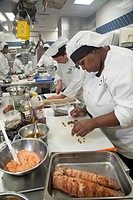 Roseville, Michigan - A student prepares food at the Dorsey Culinary Academy, a private career training school
