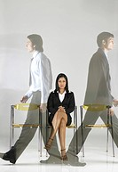 South Asian Indian executive woman sitting and men walking MR