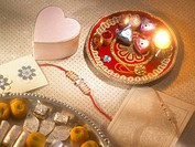 Diya rakhi chocolates arrange in thali for Rakshabandhan festival