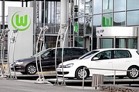 Logo of VfL Wolfsburg soccer team and Volkswagen vehicles in front of the Volkswagen Arena Wolfsburg, soccer stadium, Wolfsburg, Lower Saxony, Germany...