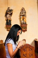 Woman prays in a church