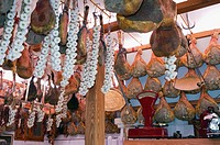 Ham hanging from the ceiling in a delicatessen shop, Norcineria Falorni, Greve, Chianti, Tuscany, Italy, Europe