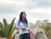 Woman looking at ruined buildings