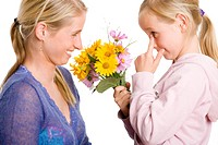 Girl giving flowers to her mother