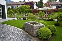 STONE FOUNTAIN IN MODERN GARDEN