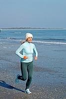 woman jogging at the sea