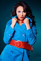 Elegant fashionable woman in blue jacket