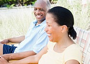 Black couple laughing outdoors together