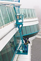 Cruise ship worker washes windows on exterior of the Jewel of the Seas cruise ship while in port Saint John, New Brunswick, Canada