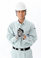 Construction worker with his hands clasped