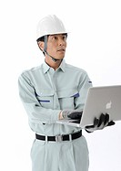 Construction worker working on laptop