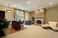 Basement in luxury home with brick fireplace