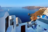 Caldera view with ferry in early morning in the town of Oia in Santorini, Greece