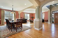Dining room in open floor plan with foyer view