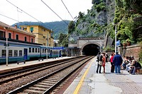 Tourists waiting for the local train at the Monterosso station in the Cinque Terre region of Italy