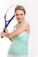 Portrait of pretty tennis player holding racket while waiting for ball