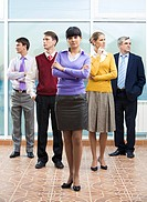 Confident business lady standing in front of group of people