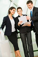 Image of business persons holding the documents and discussing its