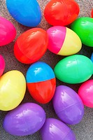 An assortment of brightly colored plastic Easter eggs