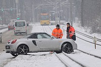 Snow in Stuttgart, a car having skid onto the S-Bahn tram tracks, Stuttgart, Baden-Wuerttemberg, Germany, Europe