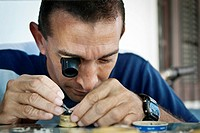 Man repairing a watch with a monocle  Santiago de Cuba, Cuba, Caribbean