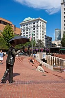 Bronze figure with an umbrella on the Pioneer Courthouse Square, Portland, Oregon, USA