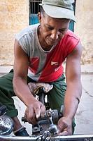 Street worker sharpening a tool, La Habana, Cuba, Caribbean