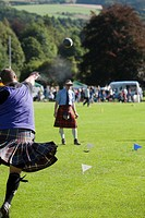Man throwing shot put, Highland Games, Pitlochry, Perthshire, Scotland