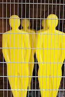 Yellow Football dummies behind wire fence, Munich, Germany