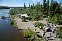 Tourists on Riverboat Discovery tour walk about Indian village along Chena River, Fairbanks, Interior Alaska, Summer
