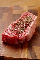 Seasoned raw steak