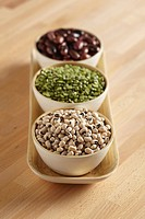 Three dishes of beans and lentils