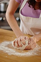 Woman kneading dough