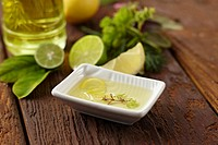 Dish of lemon and olive oil