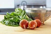 Beets and colander on kitchen counter