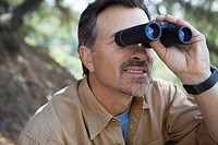 Man outdoors with binoculars