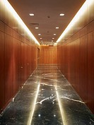 Wood paneled hallway with marble floor
