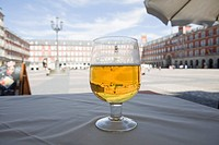 Beer glass on cafe table, Plaza Mayor, Madrid, Spain