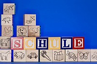 Child's wooden bricks spelling German word for School