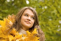 Portrait of face of beautiful woman in autumnal environment